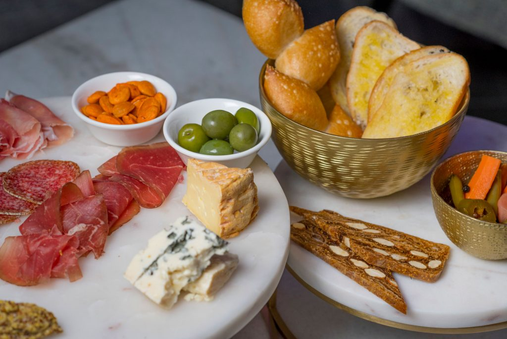Enjoy the small or large charcuterie plate with your cocktail