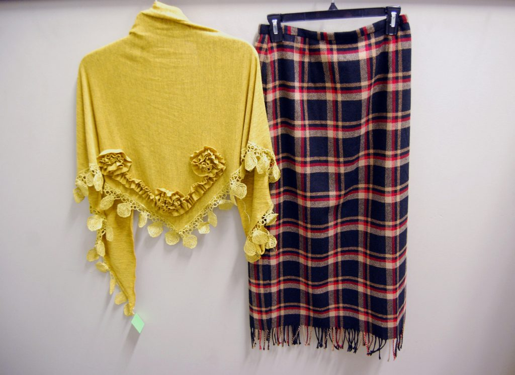 Bethany's offers unique finds like this yellow shawl and flannel skirt.