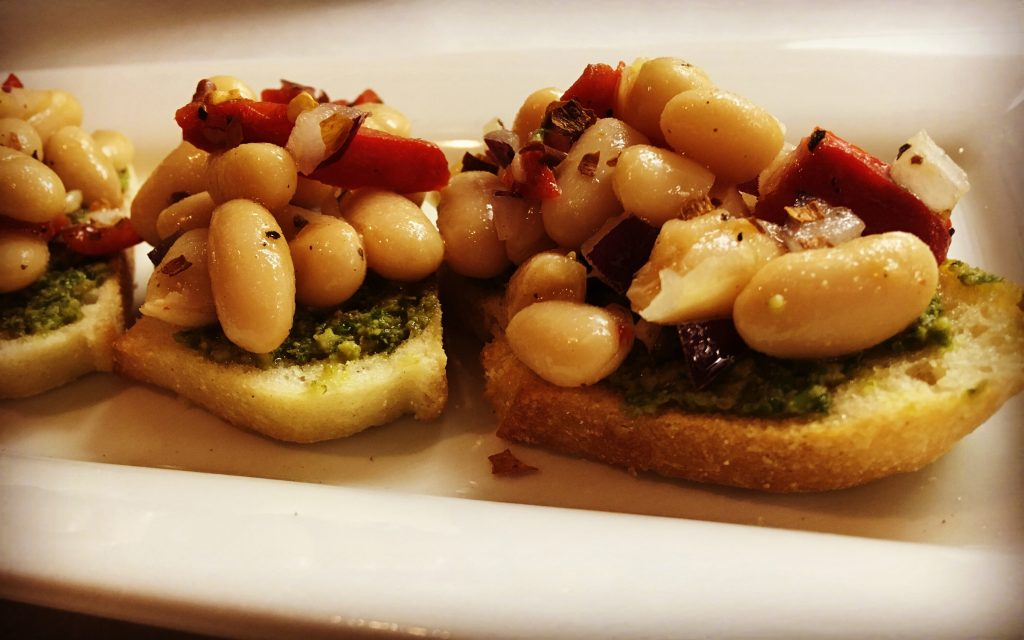 Bier Distillery is offering two Michigan cocktails with an appetizer as part of Cocktail Week. Give the white bean pesto crostini a try.