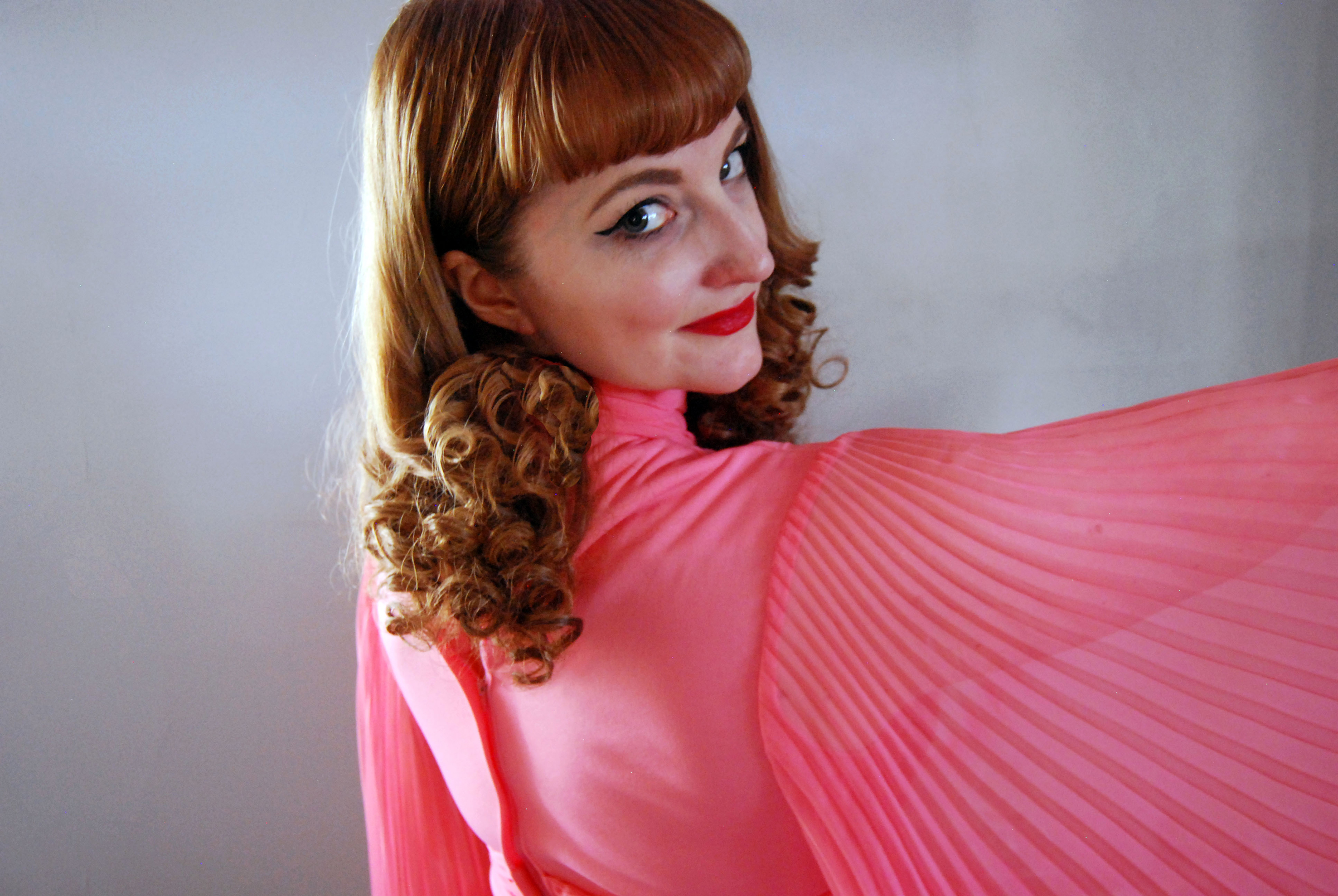 Amy Baird shows off her pink accordion sleeve vintage find.