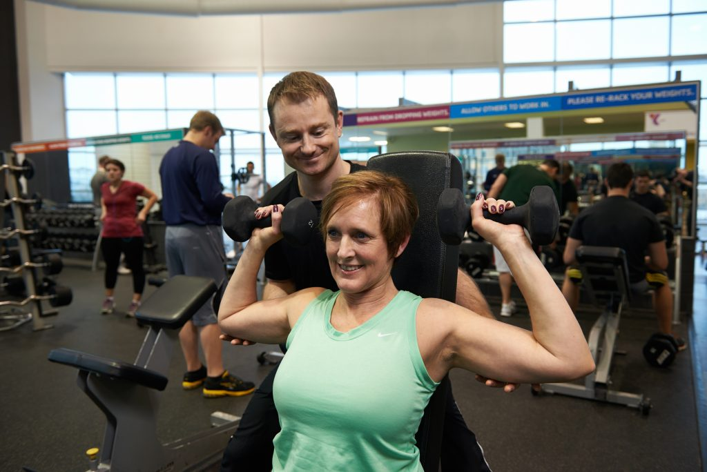 YMCA trainers work with clients to create a personalize workout plan.