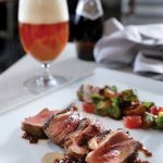Reserve, roasted lamb loin paired with Orval Trappist Belgian ale, Photo by Michael Buck, M-Buck Studio