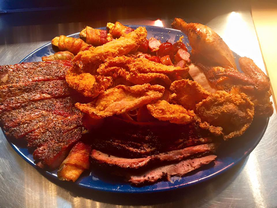 Main Street BBQ, Pork Ribs, Brisket, Pulled Pork, Smoked Chicken, Chicken Skins, Jalapeños, Sausage and Cornbread