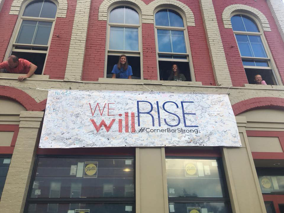Corner Bar We Will Rise Sign