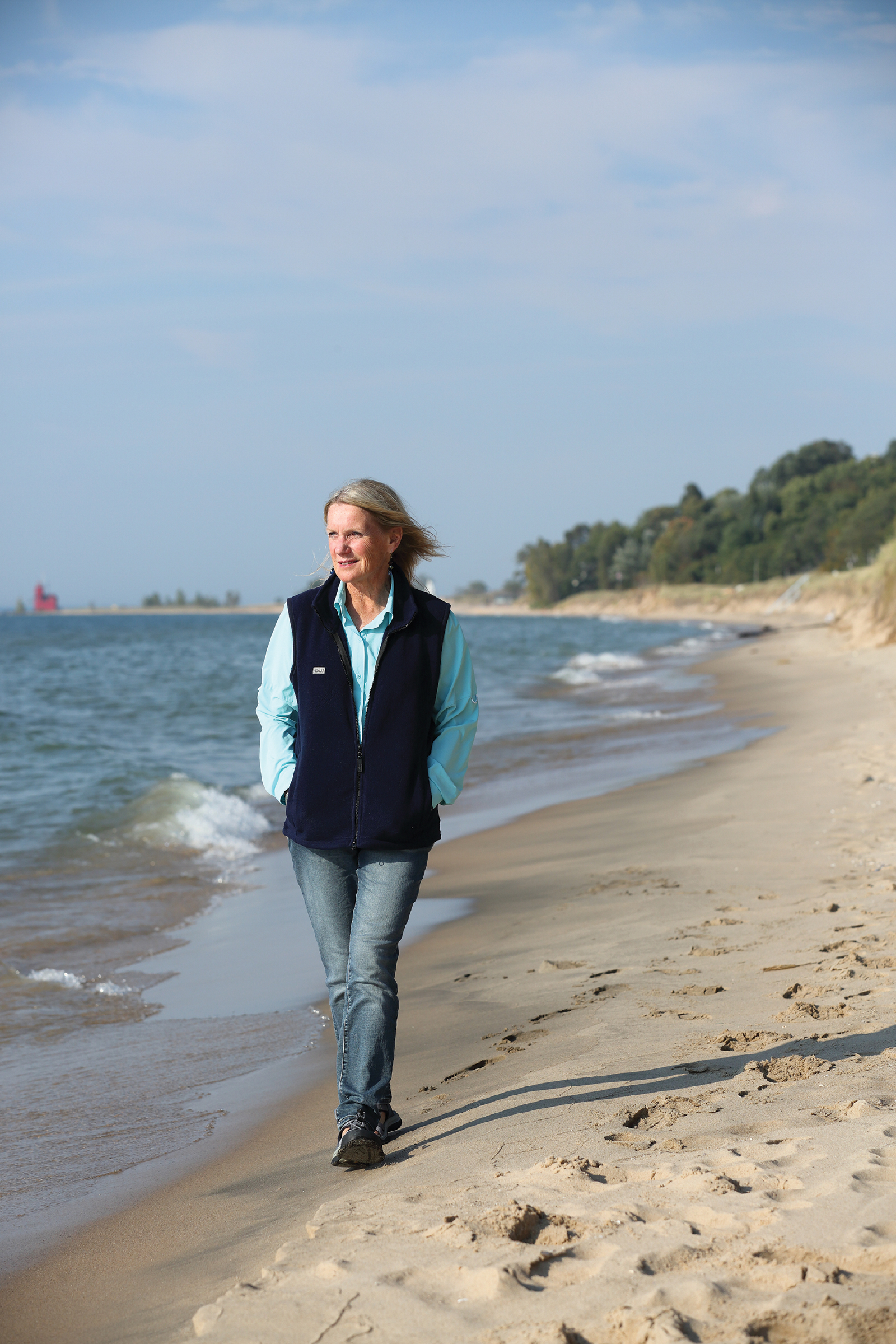 Author Mary McKSchmidt walks along the beach near their home in Holland, Michigan.
