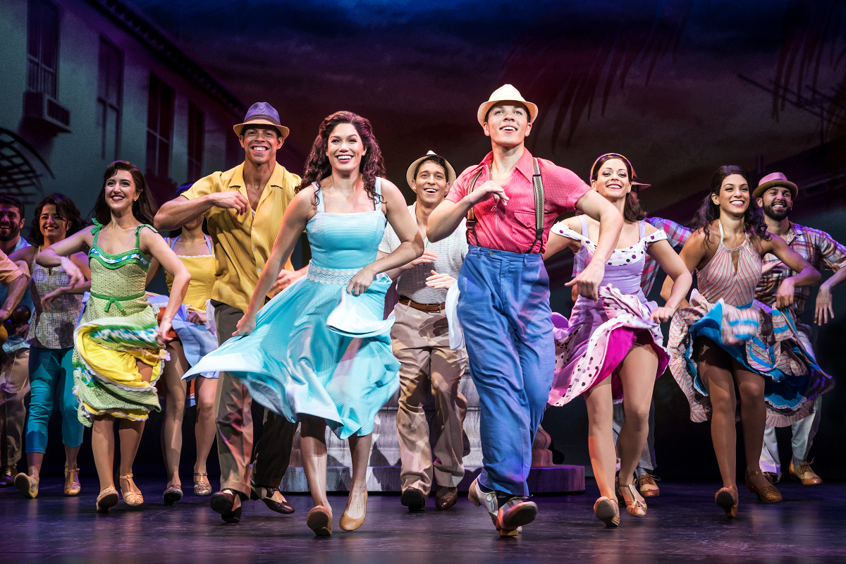 Christie Prades as Gloria Estefan and Adriel Flete and company in On Your Feet! © Matthew Murphy