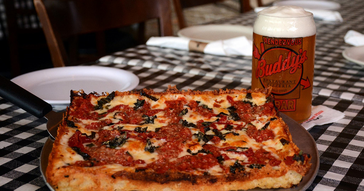 Buddy's Pizza and beer glass