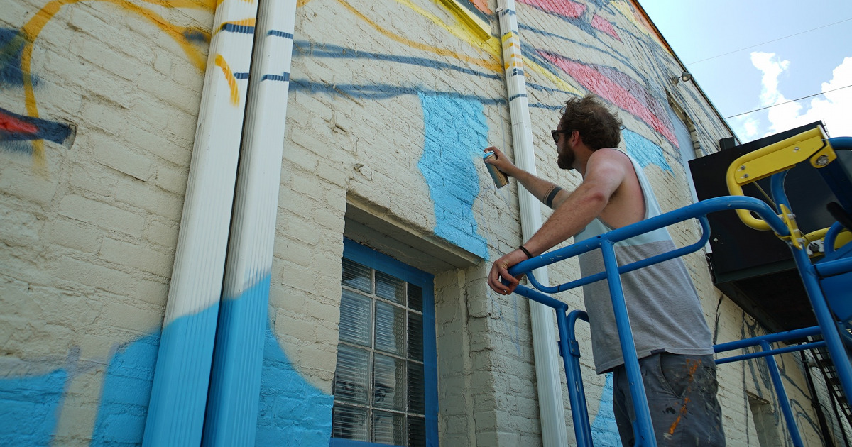 Creston neighborhood artist working on mural