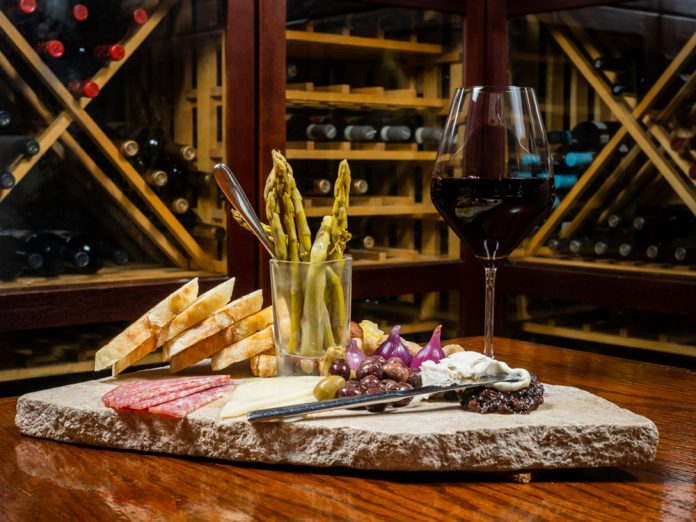 Divani wine glass and charcuterie board