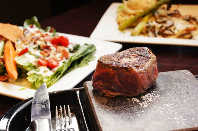 There's a new steakhouse in town. Black Rock Bar & Grill opened today in a 9,000-square-foot space in the new Van Maur wing of Woodland Mall in Kentwood, at 3195 28th St. SE. It is the first Black Rock in West Michigan. The chain has eight other locations in the state. Black Rock allows guests to sear their steak or seafood on